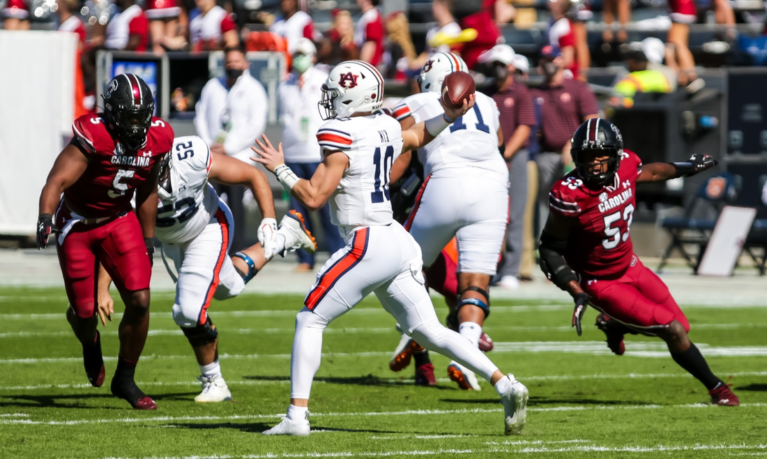 Oct 17, 2020; Columbia, South Carolina, USA; Auburn Tigers quarterback Bo Nix (10) passes against the South Carolina Gamecocks during the first quarter at Williams-Brice Stadium. Mandatory Credit: Jeff Blake-USA TODAY Sports