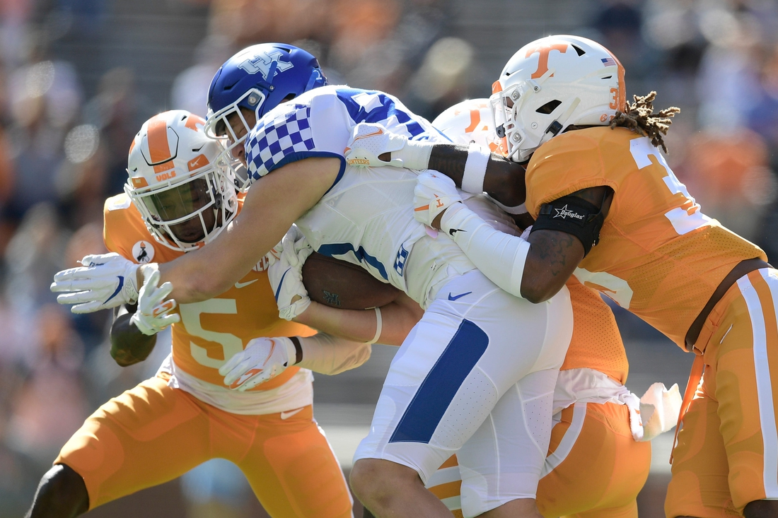 Oct 17, 2020; Knoxville, TN, USA; The Vols tackle a Kentucky player in the first quarter of a game between Tennessee and Kentucky at Neyland Stadium in Knoxville, Tenn. on Saturday, Oct. 17, 2020. Mandatory Credit: Calvin Mattheis-USA TODAY NETWORK
