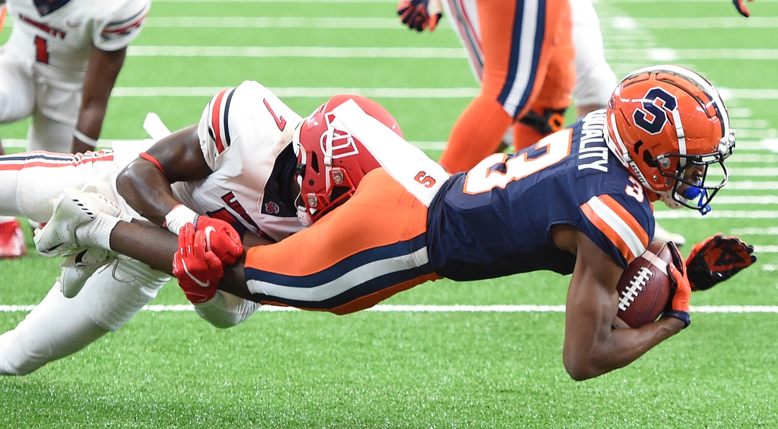 Oct 17, 2020; Syracuse, NY, USA;  Syracuse Orange wide receiver Taj Harris (3) is tackled after a reception in the first half during a game against Liberty  on Saturday, Oct. 17, 2020, at the Carrier Dome in Syracuse, N.Y. Mandatory Credit: Dennis Nett/Pool Photo-USA TODAY Sports