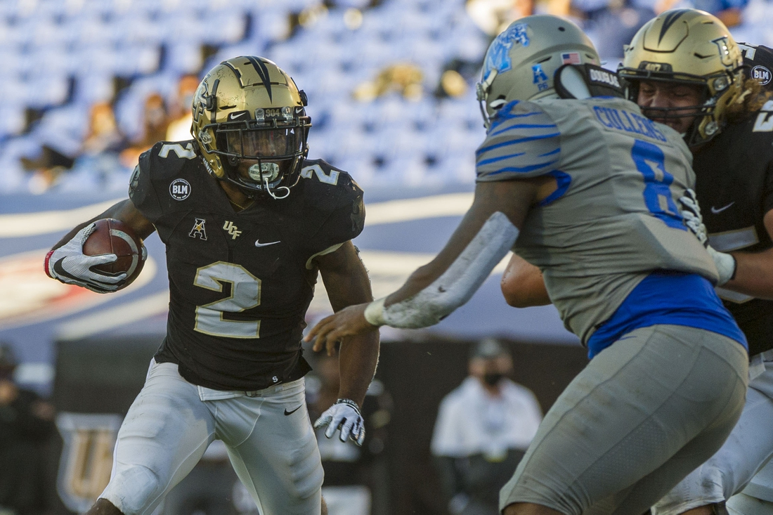 Oct 17, 2020; Memphis, Tennessee, USA; UCF Knights running back Otis Anderson (2) carries the ball against Memphis Tigers linebacker Xavier Cullens (8) during the second half  at Liberty Bowl Memorial Stadium. Mandatory Credit: Justin Ford-USA TODAY Sports