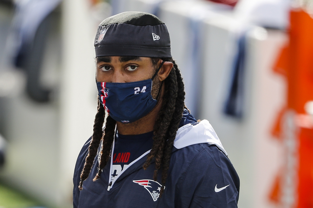 Oct 18, 2020; Foxborough, Massachusetts, USA; New England Patriots cornerback Stephon Gilmore (24) leaves the field after warming up before a game against the Denver Broncos at Gillette Stadium. Mandatory Credit: Winslow Townson-USA TODAY Sports