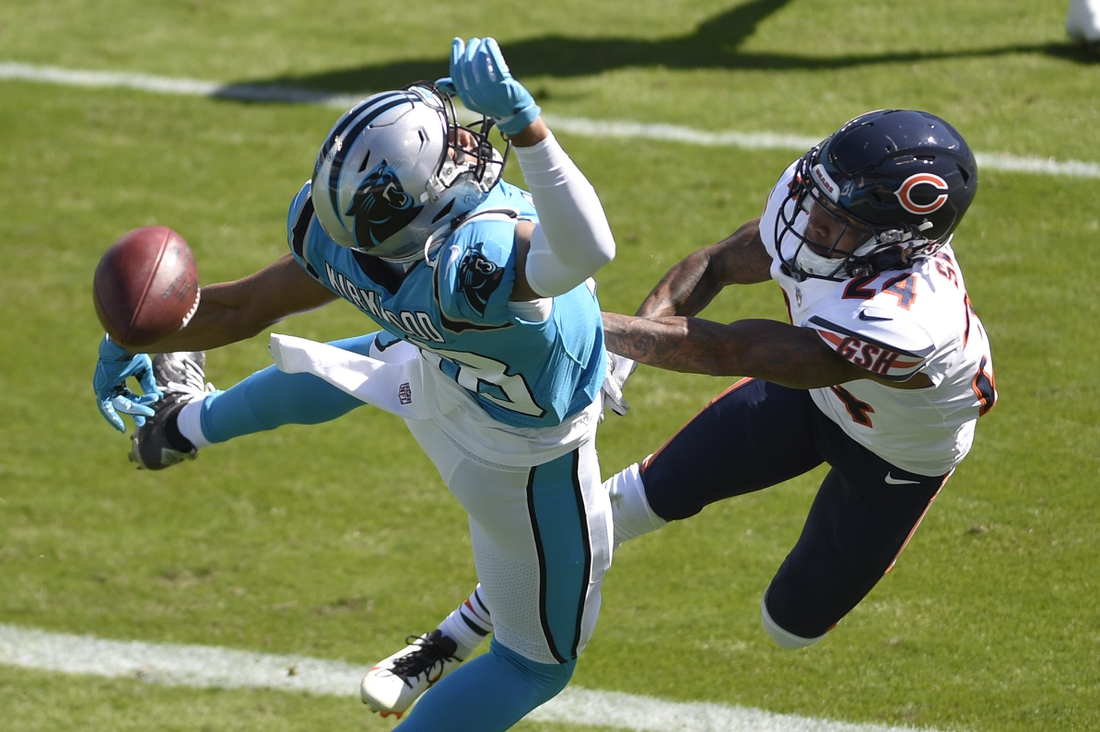 Oct 18, 2020; Charlotte, North Carolina, USA;  Chicago Bears defensive back Buster Skrine (24) braces up a pass intended for Carolina Panthers wide receiver Kieth Kirkwood (18)  in the first quarter at Bank of America Stadium. Mandatory Credit: Bob Donnan-USA TODAY Sports
