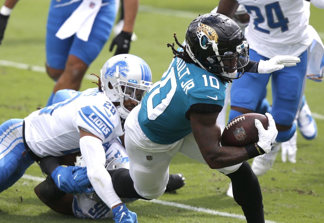 Oct 18, 2020; Jacksonville, Florida, USA; Jacksonville Jaguars wide receiver Laviska Shenault Jr. (10) is tackled by Detroit Lions cornerback Darryl Roberts (29) during the first quarter at TIAA Bank Field. Mandatory Credit: Reinhold Matay-USA TODAY Sports