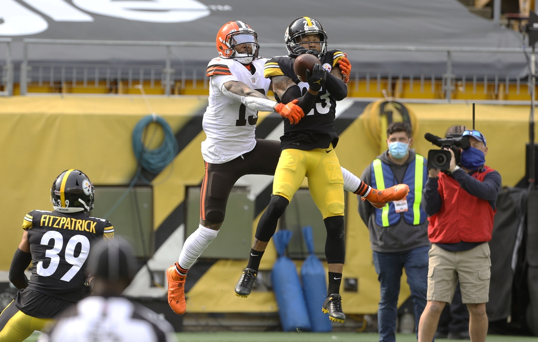 Oct 18, 2020; Pittsburgh, Pennsylvania, USA;  Pittsburgh Steelers cornerback Joe Haden (23) breaks up a pass intended for Cleveland Browns wide receiver Odell Beckham Jr. (13) during the second quarter at Heinz Field. Mandatory Credit: Charles LeClaire-USA TODAY Sports