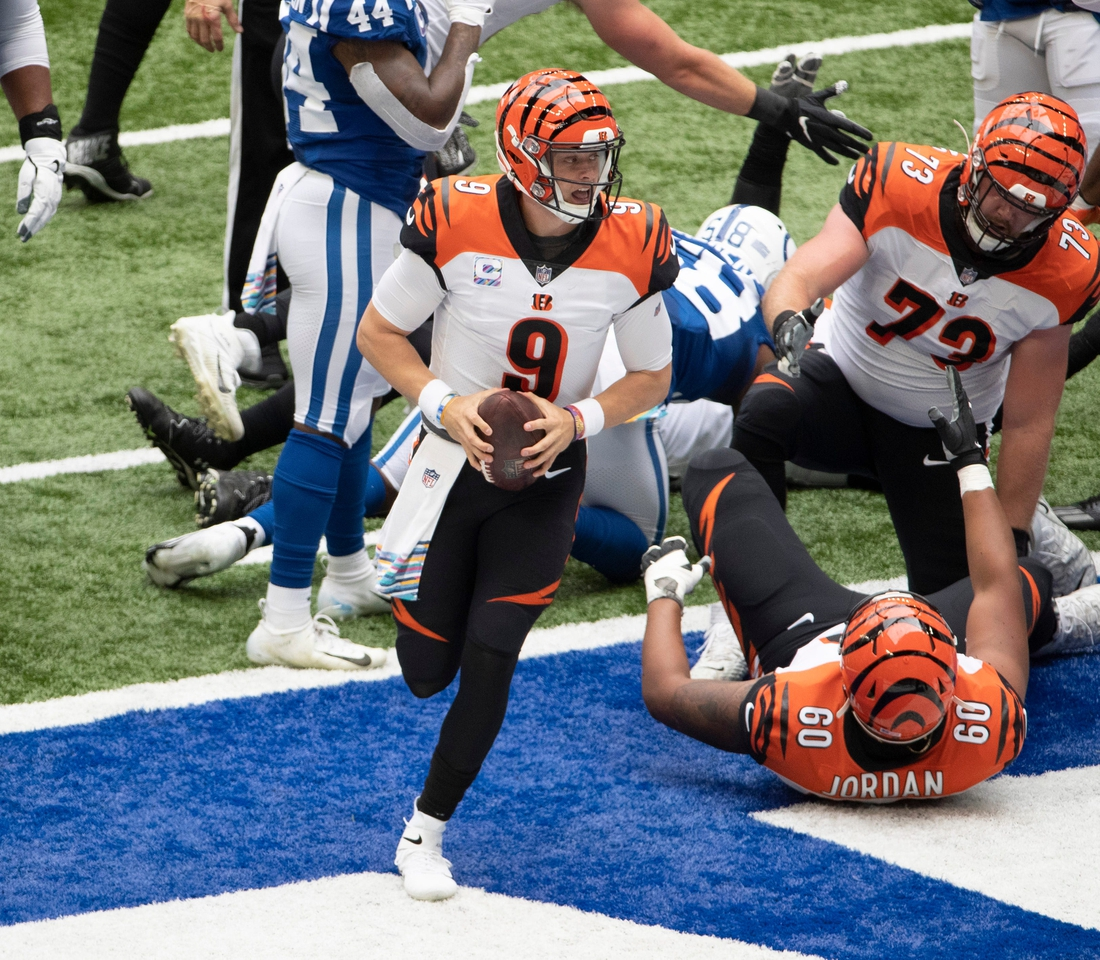 Oct 18, 2020; Indianapolis, IN, USA; Cincinnati Bengals quarterback Joe Burrow (9) celebrates after scoring a touchdown in the first quarter as the Indianapolis Colts host the Cincinnati Bengals at Lucas Oil Stadium in Indianapolis, Ind. on Saturday, October 18, 2020. Mandatory Credit: Colin Boyle-USA TODAY NETWORK