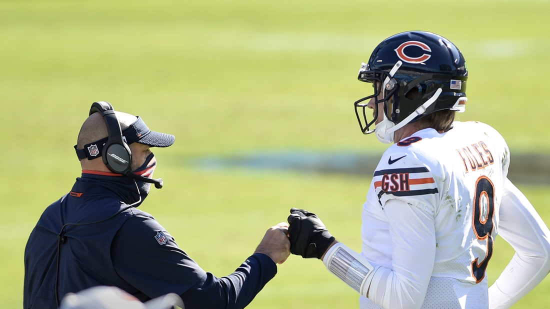 Oct 18, 2020; Charlotte, North Carolina, USA; Chicago Bears head coach Matt Nagy with quarterback Nick Foles (9) in the third quarter at Bank of America Stadium. Mandatory Credit: Bob Donnan-USA TODAY Sports