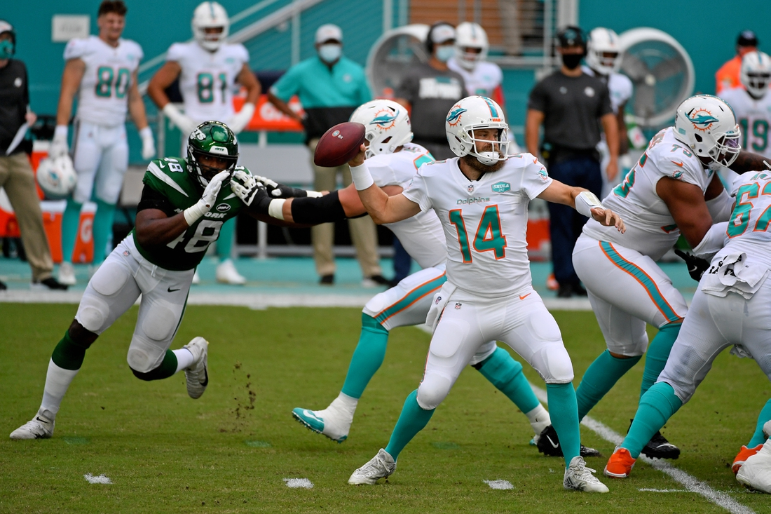Oct 18, 2020; Miami Gardens, Florida, USA; Miami Dolphins quarterback Ryan Fitzpatrick (14) attempts a pass against the New York Jets during the first half at Hard Rock Stadium. Mandatory Credit: Jasen Vinlove-USA TODAY Sports