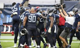 Oct 18, 2020; Nashville, Tennessee, USA; Tennessee Titans running back Derrick Henry (22) and his teammates celebrate the overtime win on a five yard touchdown run during the over time period at Nissan Stadium. Mandatory Credit: Steve Roberts-USA TODAY Sports