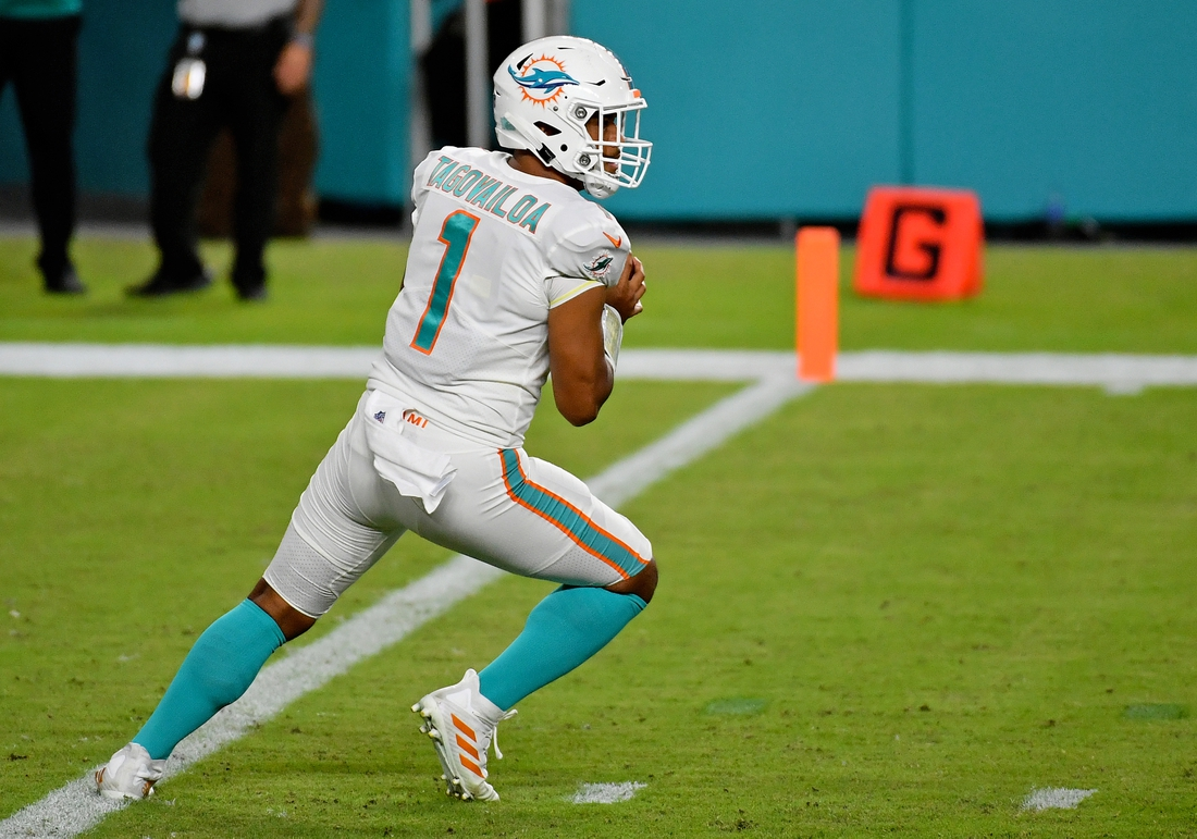 Oct 18, 2020; Miami Gardens, Florida, USA; Miami Dolphins quarterback Tua Tagovailoa (1) drops back during the second half against the New York Jets at Hard Rock Stadium. Mandatory Credit: Jasen Vinlove-USA TODAY Sports