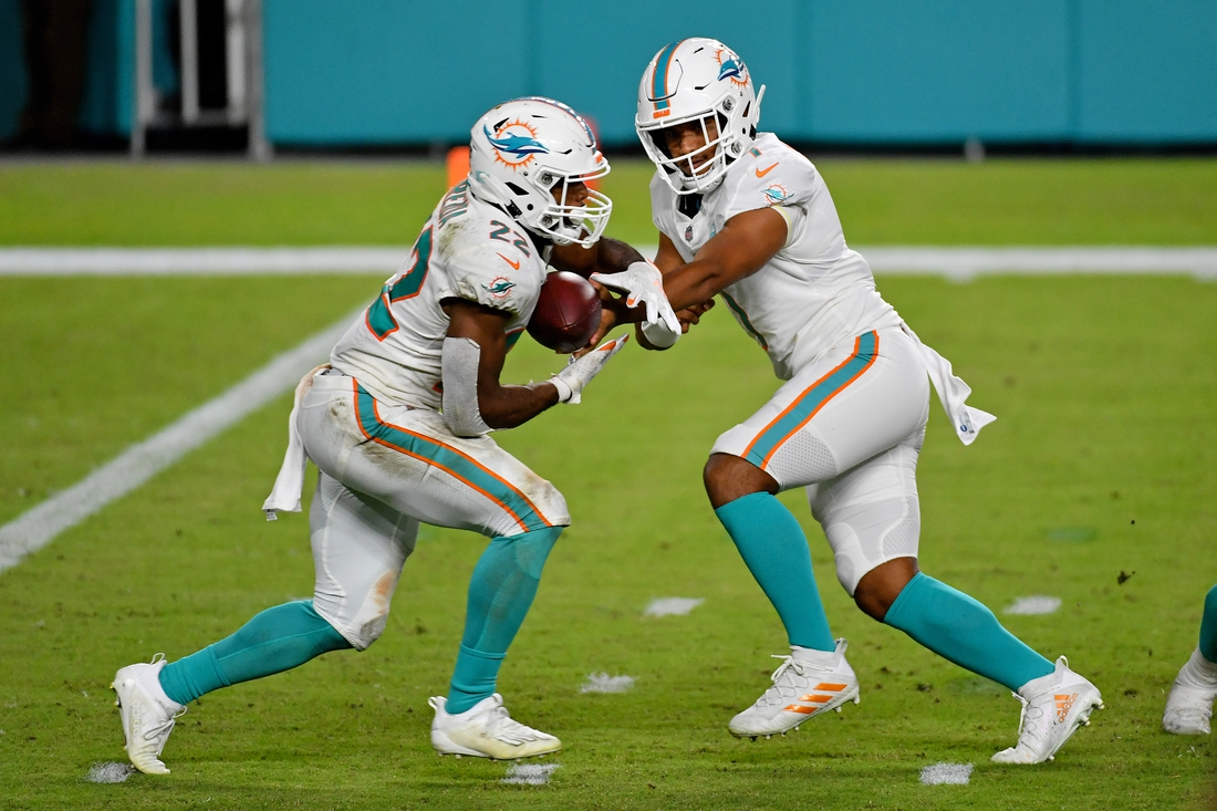 Oct 18, 2020; Miami Gardens, Florida, USA; Miami Dolphins quarterback Tua Tagovailoa (1) hands the ball to running back Matt Breida (22) during the second half against the New York Jets at Hard Rock Stadium. Mandatory Credit: Jasen Vinlove-USA TODAY Sports