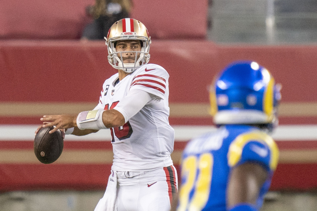 October 18, 2020; Santa Clara, California, USA; San Francisco 49ers quarterback Jimmy Garoppolo (10) passes the football against the Los Angeles Rams during the second quarter at Levi's Stadium. Mandatory Credit: Kyle Terada-USA TODAY Sports