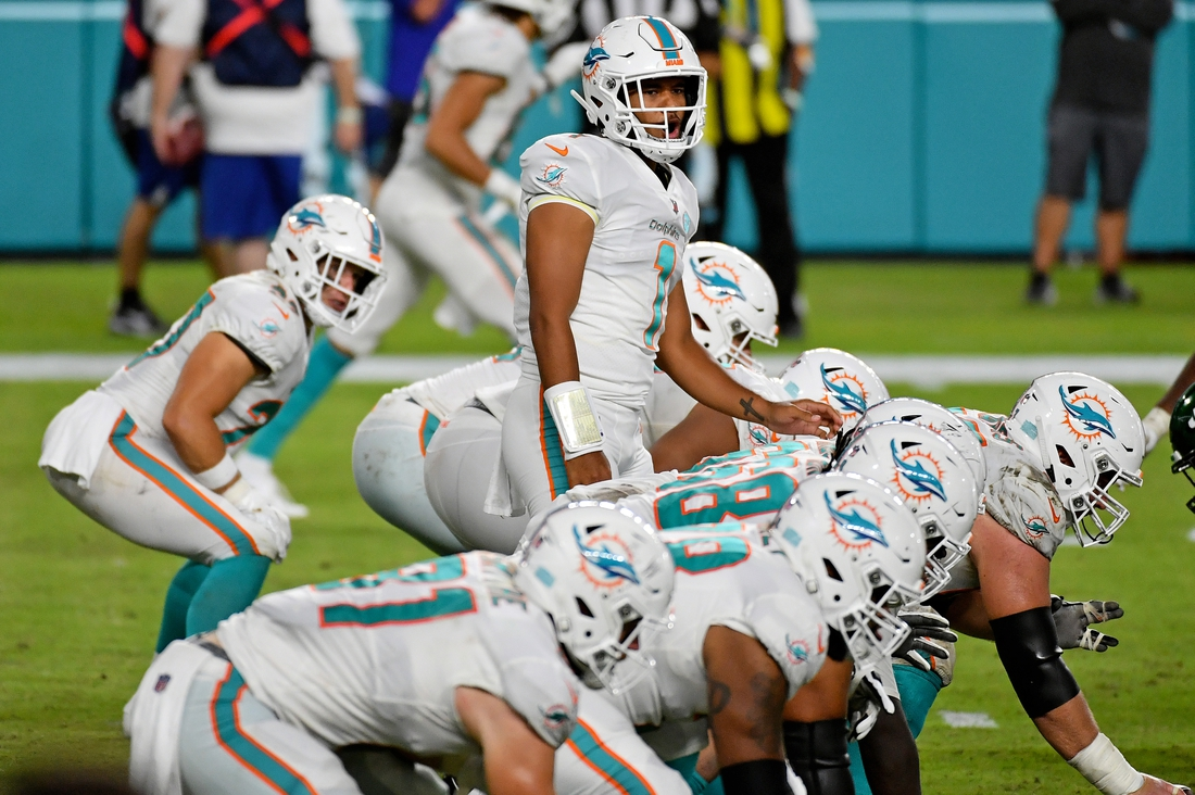 Oct 18, 2020; Miami Gardens, Florida, USA; Miami Dolphins quarterback Tua Tagovailoa (1) looks over the offensive line during the second half against the New York Jets at Hard Rock Stadium. Mandatory Credit: Jasen Vinlove-USA TODAY Sports