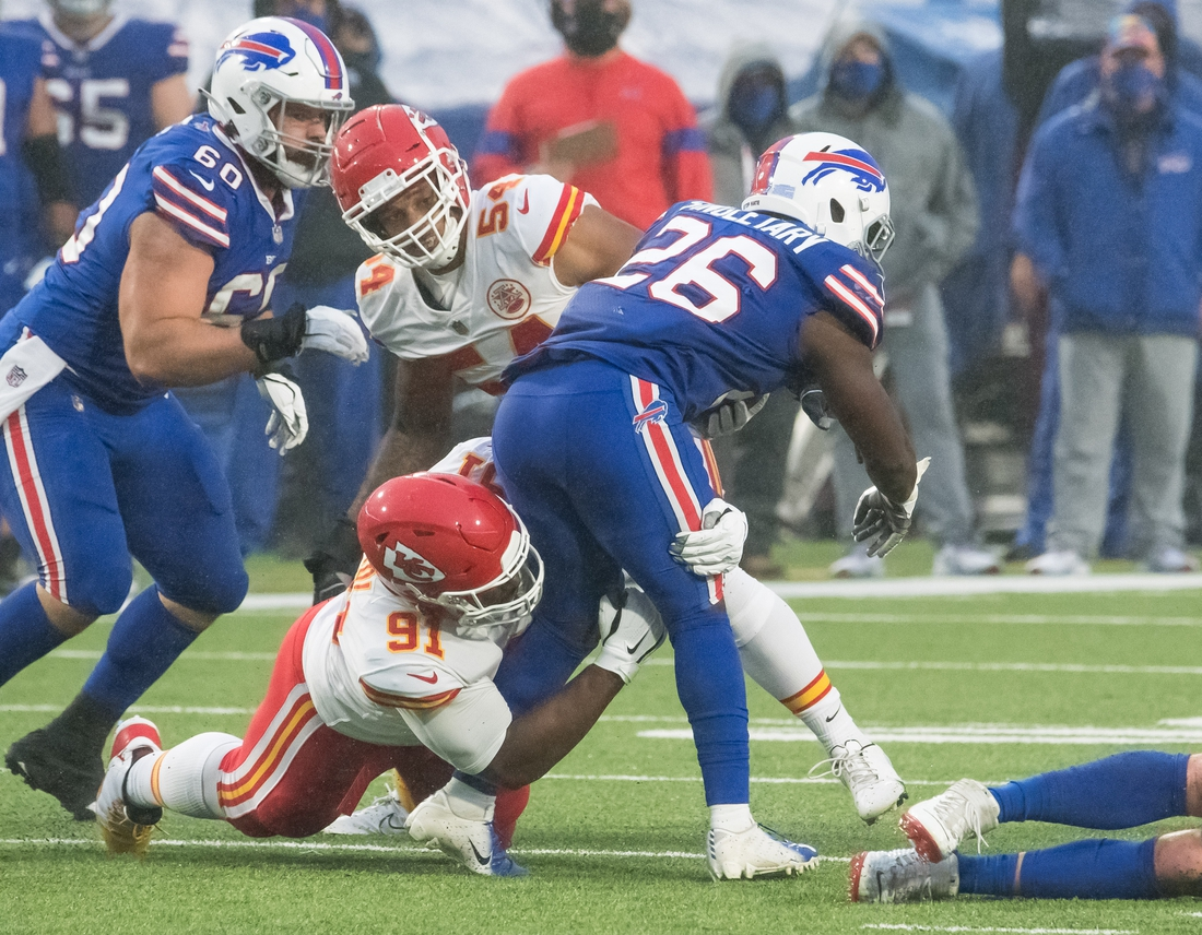 Oct 19, 2020; Orchard Park, New York, USA; Kansas City Chiefs defensive tackle Derrick Nnadi (91) tackles Buffalo Bills running back Devin Singletary (26) in the first quarter at Bills Stadium. Mandatory Credit: Mark Konezny-USA TODAY Sports
