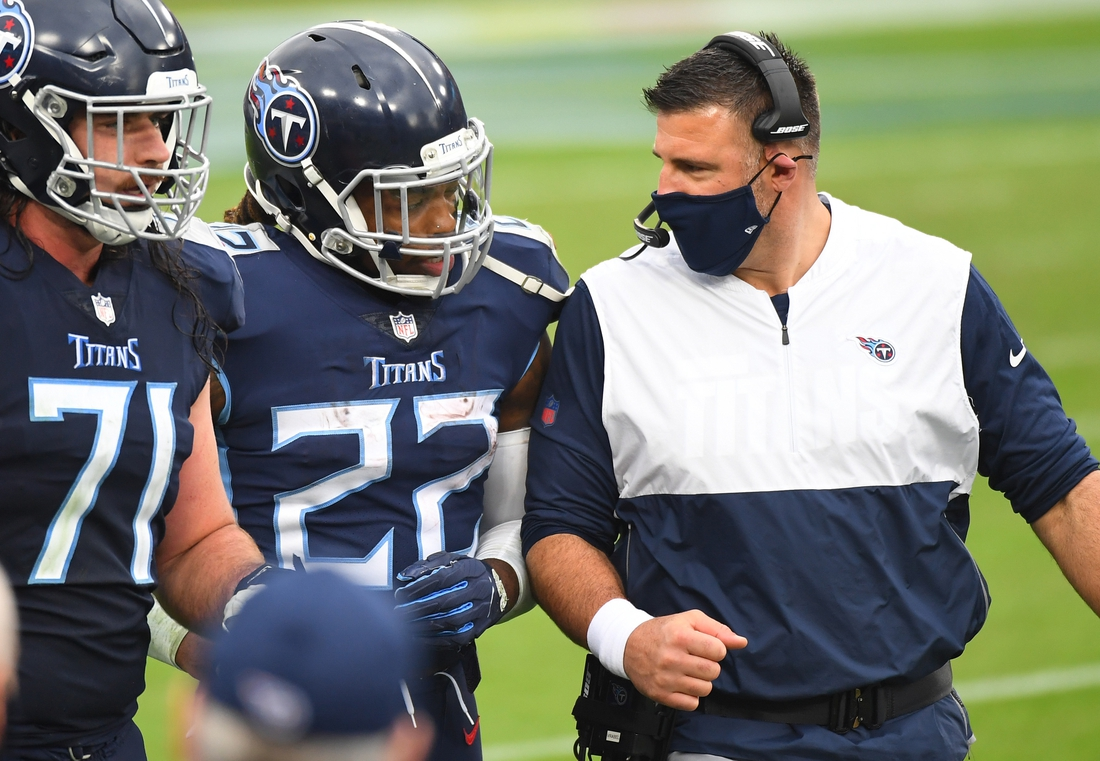 Oct 18, 2020; Nashville, Tennessee, USA; Tennessee Titans running back Derrick Henry (22) is congratulated by Tennessee Titans head coach Mike Vrabel after a touchdown run during the second half against the Houston Texans at Nissan Stadium. Mandatory Credit: Christopher Hanewinckel-USA TODAY Sports