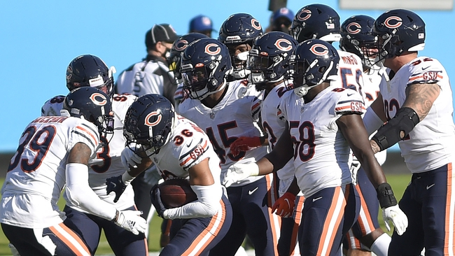 Oct 18, 2020; Charlotte, North Carolina, USA; Chicago Bears defensive back DeAndre Houston-Carson (36) celebrates with teammates after intercepting the ball in the fourth quarter at Bank of America Stadium. Mandatory Credit: Bob Donnan-USA TODAY Sports