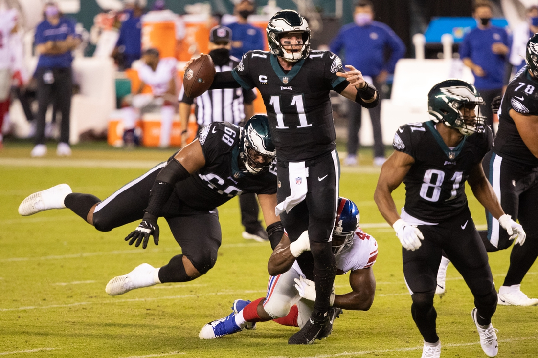 Oct 22, 2020; Philadelphia, Pennsylvania, USA; Philadelphia Eagles quarterback Carson Wentz (11) is hit by New York Giants linebacker Markus Golden (44) while attempting a pass during the second quarter at Lincoln Financial Field. Mandatory Credit: Bill Streicher-USA TODAY Sports