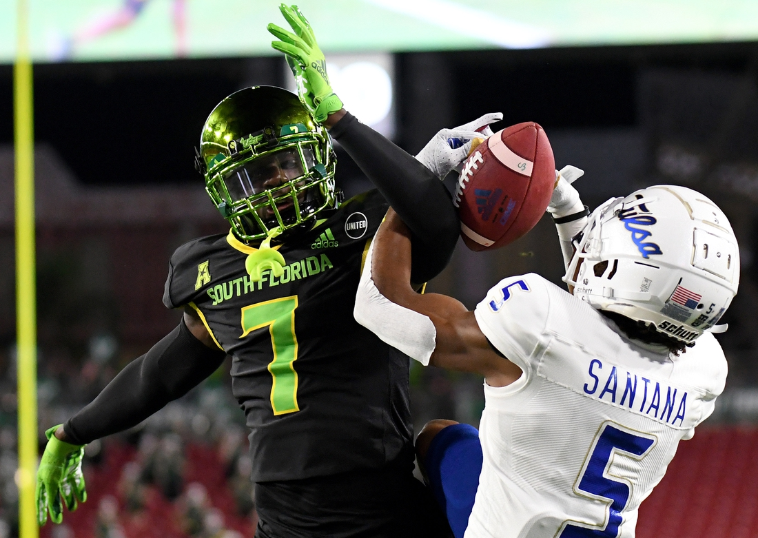 Oct 23, 2020; Tampa, Florida, USA; Tulsa Golden Hurricane wide receiver Juancarlos Santana (5) catches a touchdown pass as South Florida Bulls defensive back Mike Hampton (7) defends in the first half at Raymond James Stadium. Mandatory Credit: Jonathan Dyer-USA TODAY Sports