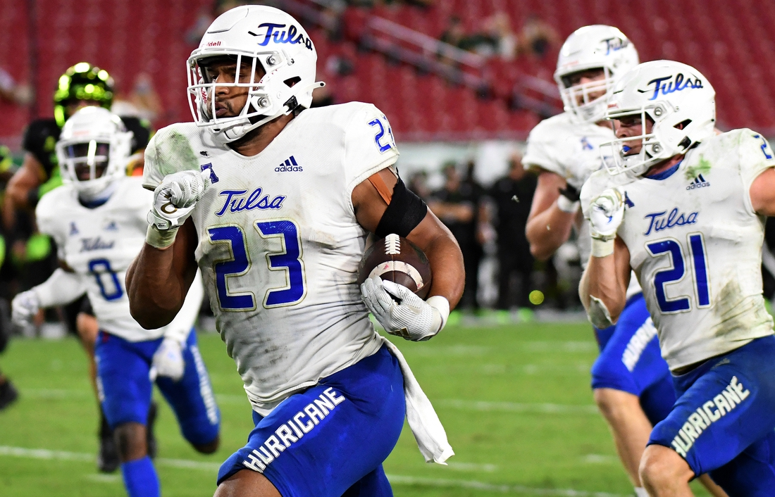 Oct 23, 2020; Tampa, Florida, USA; Tulsa Golden Hurricane linebacker Zaven Collins (23) returns an interception for a touchdown in the second half against the South Florida Bulls at Raymond James Stadium. Mandatory Credit: Jonathan Dyer-USA TODAY Sports
