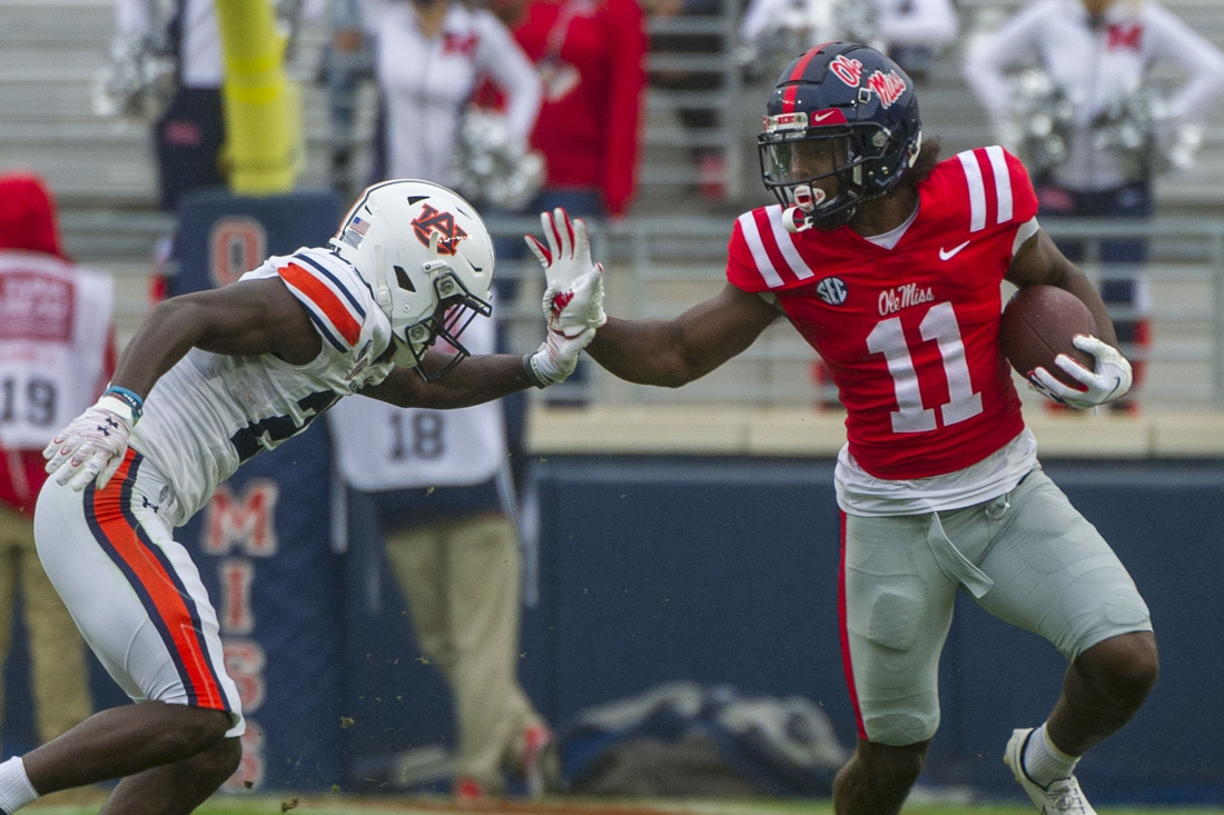 Oct 24, 2020; Oxford, Mississippi, USA; Mississippi Rebels wide receiver Dontario Drummond (11) blocks a tackle from Auburn Tigers defensive back Trey Elston (22) at Vaught-Hemingway Stadium. Mandatory Credit: Justin Ford-USA TODAY Sports