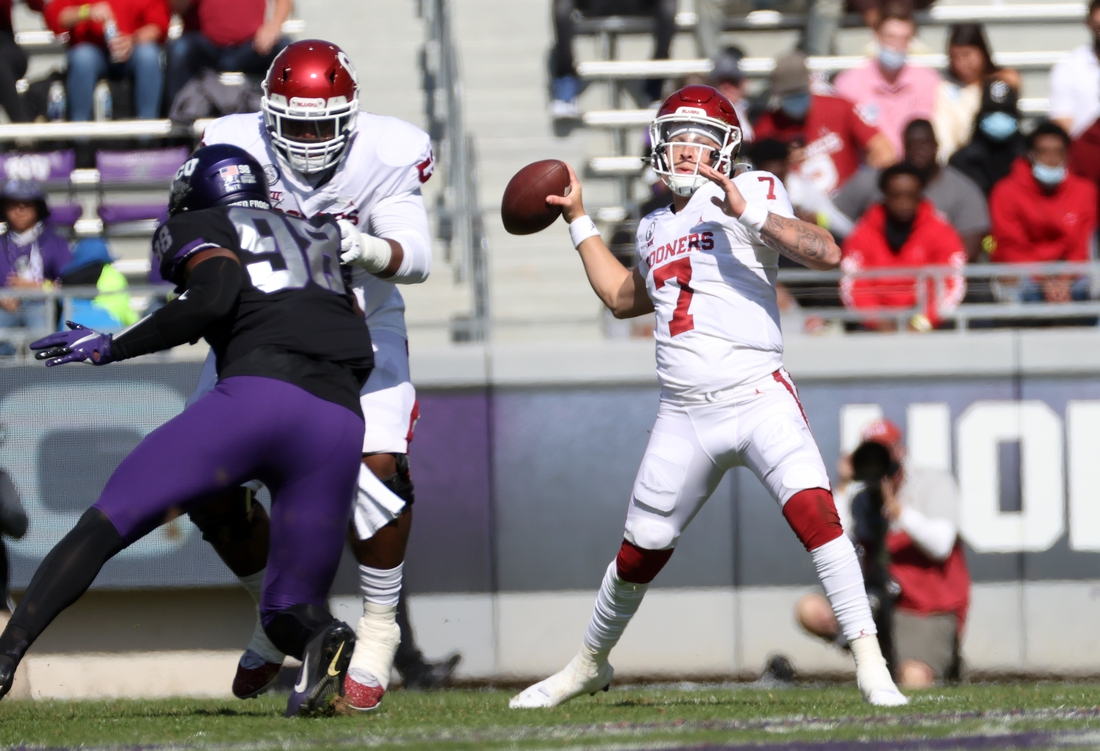 Oct 24, 2020; Fort Worth, Texas, USA;  Oklahoma Sooners quarterback Spencer Rattler (7) throws during the first half against the TCU Horned Frogs at Amon G. Carter Stadium. Mandatory Credit: Kevin Jairaj-USA TODAY Sports