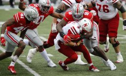 Oct 24, 2020; Columbus, Ohio, USA; Nebraska Cornhuskers quarterback Adrian Martinez (2) is sacked by Ohio State Buckeyes defensive end Zach Harrison (9) during the third quarter at Ohio Stadium. Mandatory Credit: Joseph Maiorana-USA TODAY Sports