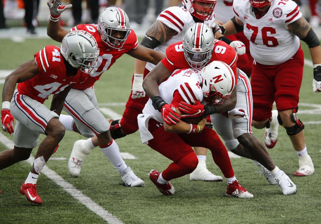 Oct 24, 2020; Columbus, Ohio, USA; Nebraska Cornhuskers quarterback Adrian Martinez (2) is sacked by Ohio State Buckeyes defensive end Zach Harrison (9) during the third quarter at Ohio Stadium. Mandatory Credit: Joseph Maiorana-USA TODAY Sports