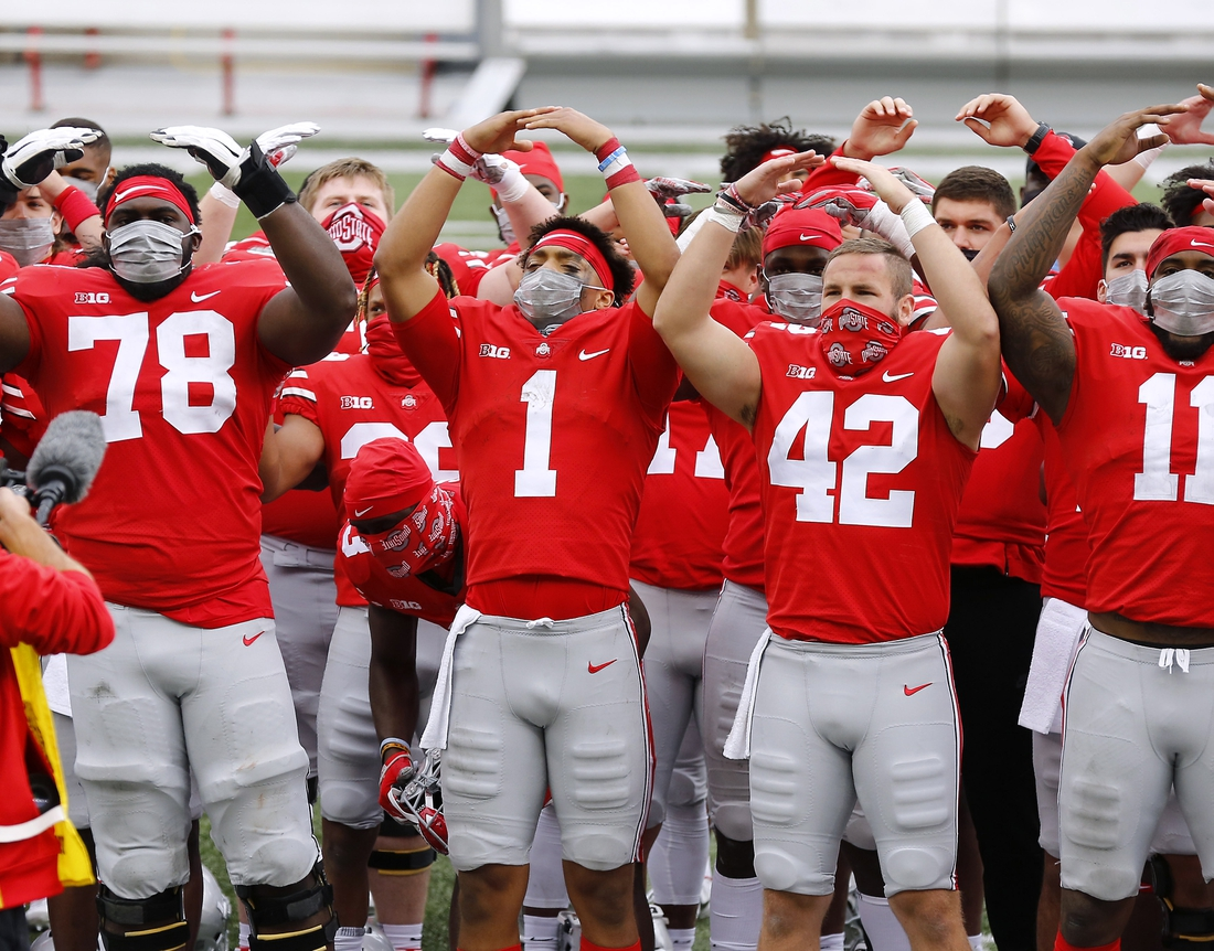 Oct 24, 2020; Columbus, Ohio, USA; Ohio State Buckeyes quarterback Justin Fields (1) and teammates celebrate the 52-17 win following the game against the Nebraska Cornhuskers at Ohio Stadium. Mandatory Credit: Joseph Maiorana-USA TODAY Sports