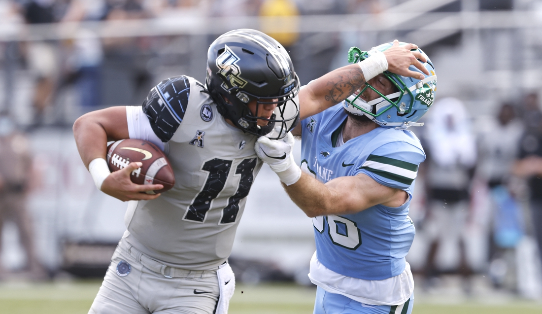 Oct 24, 2020; Orlando, Florida, USA; Tulane Green Wave safety Chase Kuerschen (36) reaches for UCF Knights quarterback Dillon Gabriel (11) during the second quarter at the  Bounce House. Mandatory Credit: Reinhold Matay-USA TODAY Sports