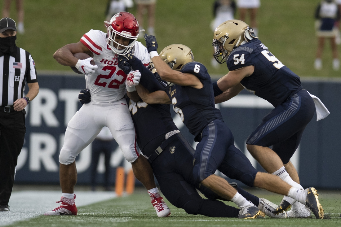 Oct 24, 2020; Annapolis, Maryland, USA;  Houston Cougars running back Kyle Porter (22) is hit out of bounds by Navy Midshipmen defenders during the Navy Midshipmen at Navy-Marine Corps Memorial Stadium. Mandatory Credit: Tommy Gilligan-USA TODAY Sports