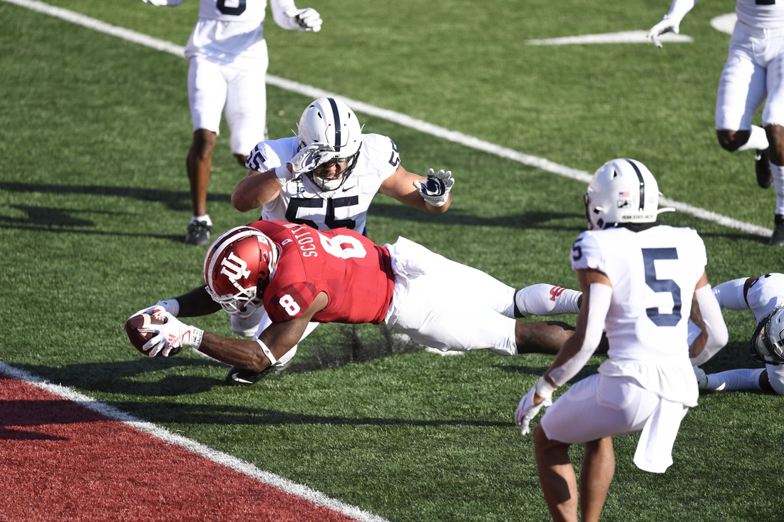 Oct 24, 2020; Bloomington, Indiana, USA; Indiana Hoosiers running back Stevie Scott III (8) dives into the end zone to score a touchdown past Penn State Nittany Lions defensive tackle Antonio Shelton (55) during the second quarter of the game at Memorial Stadium. Mandatory Credit: Marc Lebryk-USA TODAY Sports