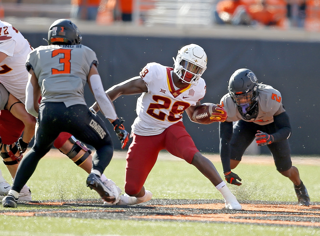 Oct 24, 2020; Stillwater, Oklahoma, USA;  Iowa State Cyclones running back Breece Hall (28) looks to get by Oklahoma State Cowboys safety Tre Sterling (3) in the second quarter at Boone Pickens Stadium. Mandatory Credit: Sarah Phipps-USA TODAY Sports
