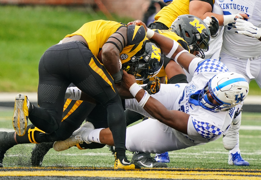 Oct 24, 2020; Columbia, Missouri, USA; Missouri Tigers running back Larry Rountree III (34) is tackled by Kentucky Wildcats defensive tackle Phil Hoskins (92) during the first half at Faurot Field at Memorial Stadium. Mandatory Credit: Jay Biggerstaff-USA TODAY Sports