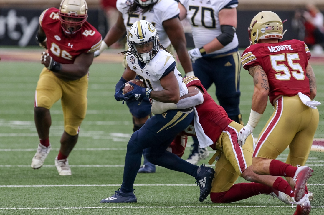 Oct 24, 2020; Chestnut Hill, Massachusetts, USA; Georgia Tech Yellow Jackets running back Jahmyr Gibbs (21) is tackled by Boston College Eagles cornerback Jahmin Muse (8) during the first half at Alumni Stadium. Mandatory Credit: Paul Rutherford-USA TODAY Sports