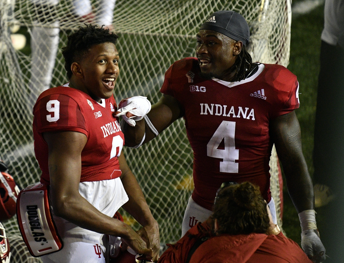 Oct 24, 2020; Bloomington, Indiana, USA;  Indiana Hoosiers quarterback Michael Penix Jr. (9) and Indiana Hoosiers linebacker Cam Jones (4) after the game at Memorial Stadium. The Indiana Hoosiers defeated the Penn State Nittany Lions 36 to 35.  Mandatory Credit: Marc Lebryk-USA TODAY Sports