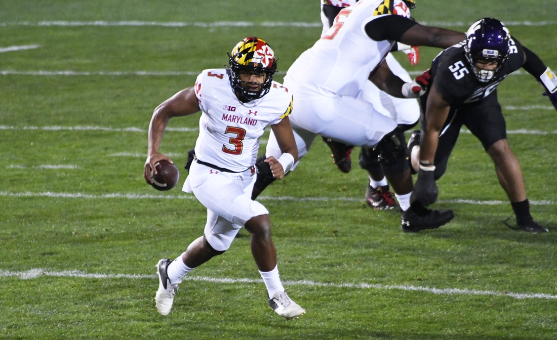 Oct 24, 2020; Evanston, Illinois, USA; Maryland Terrapins quarterback Taulia Tagovailoa (3) runs the ball against the Northwestern Wildcats during the first half at Ryan Field. Mandatory Credit: David Banks-USA TODAY Sports