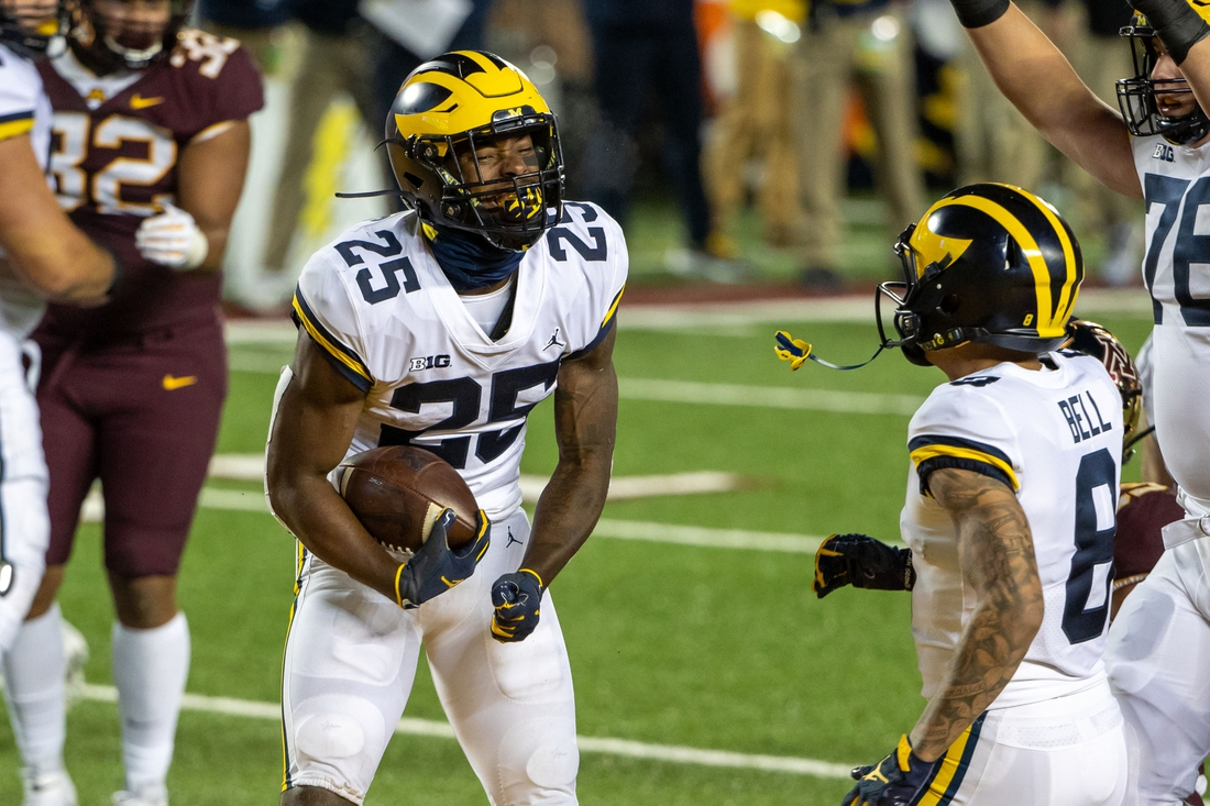 Oct 24, 2020; Minneapolis, Minnesota, USA; Michigan Wolverines running back Hassan Haskins (25) celebrates after scoring a touchdown in the first half against the Minnesota Golden Gophers at TCF Bank Stadium. Mandatory Credit: Jesse Johnson-USA TODAY Sports