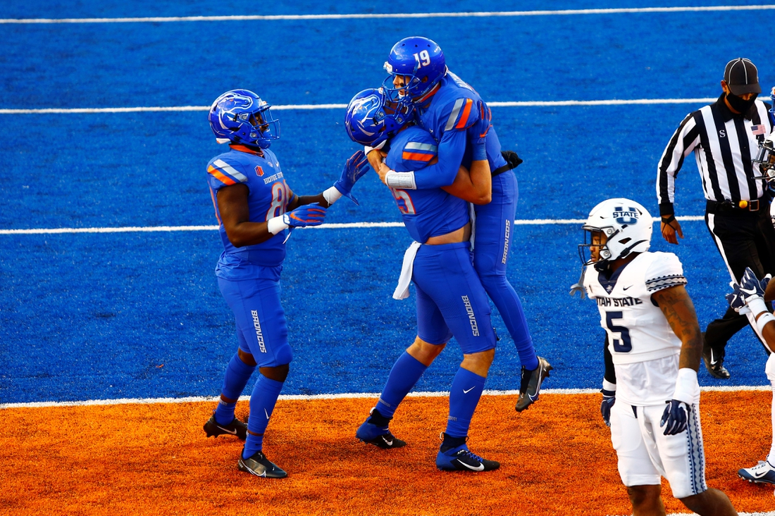 Oct 24, 2020; Boise, Idaho, USA;  Boise State Broncos quarterback Hank Bachmeier (19) celebrates a touchdown run with teammates during the first half versus the Utah State Aggies at Albertsons Stadium. Mandatory Credit: Brian Losness-USA TODAY Sports