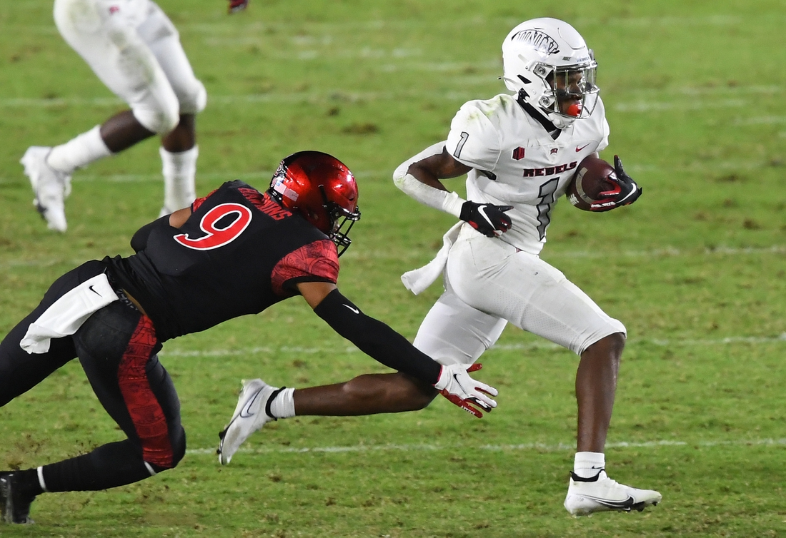 Oct 24, 2020; Carson, California, USA;  UNLV Rebels wide receiver Kyle Williams (1) gets past San Diego State Aztecs safety Tayler Hawkins (9) for a first down in the fourth quarter of the game at Dignity Health Sports Park. Mandatory Credit: Jayne Kamin-Oncea-USA TODAY Sports