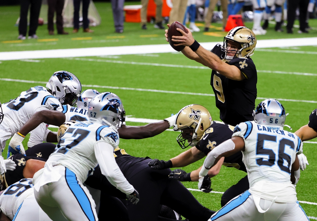 Oct 25, 2020; New Orleans, Louisiana, USA; New Orleans Saints quarterback Drew Brees (9) jumps over the line for a touchdown against the Carolina Panthers during the second quarter at the Mercedes-Benz Superdome. Mandatory Credit: Derick E. Hingle-USA TODAY Sports
