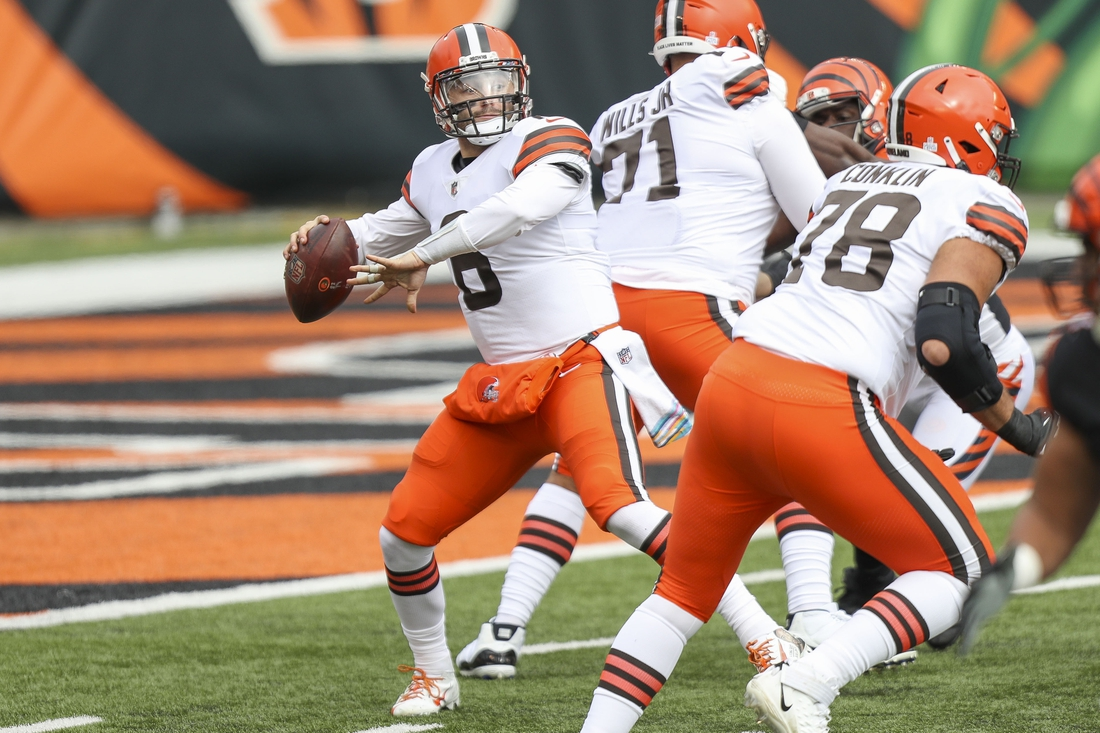Oct 25, 2020; Cincinnati, Ohio, USA; Cleveland Browns quarterback Baker Mayfield (6) looks for a receiver against the Cincinnati Bengals in the first half at Paul Brown Stadium. Mandatory Credit: Katie Stratman-USA TODAY Sports