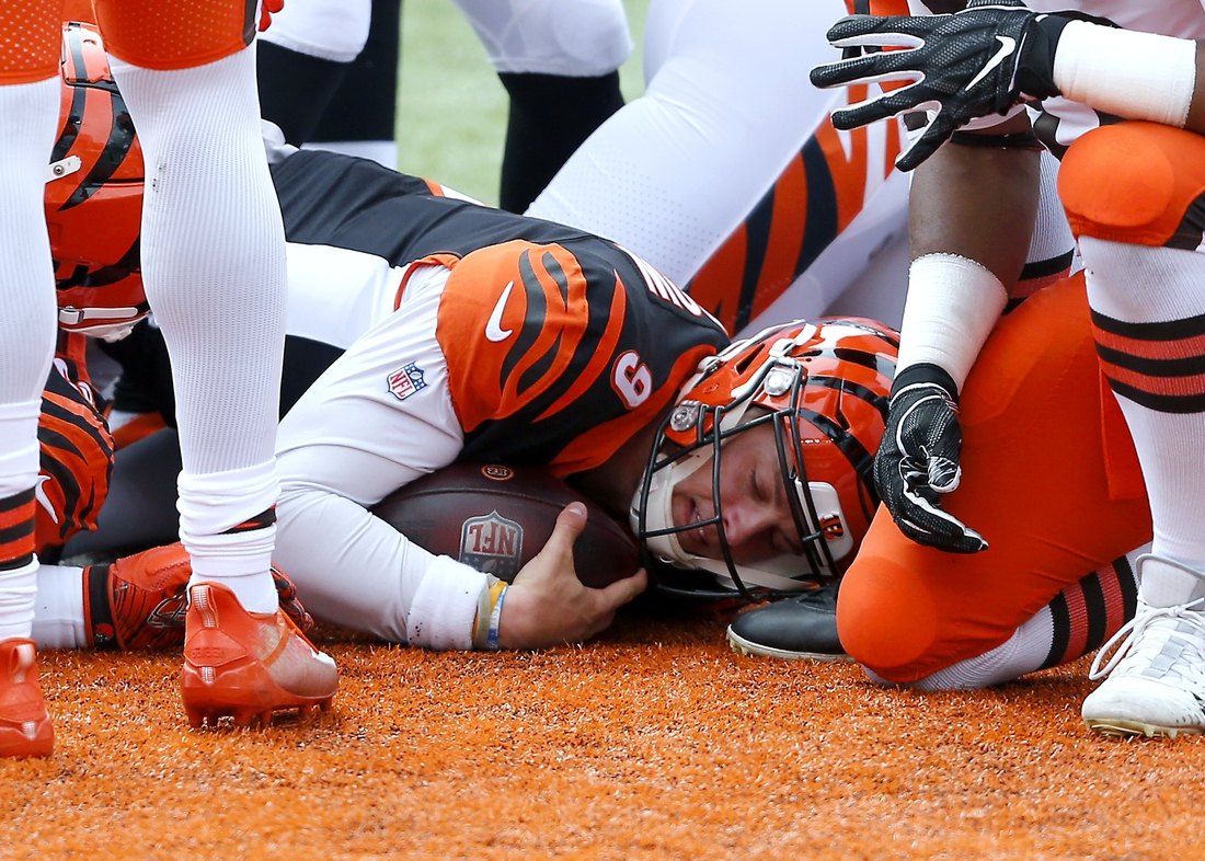 Oct 25, 2020; Cincinnati, Ohio, USA; Cincinnati Bengals quarterback Joe Burrow (9) dives in for the touchdown during the first quarter against the Cleveland Browns at Paul Brown Stadium. Mandatory Credit: Joseph Maiorana-USA TODAY Sports