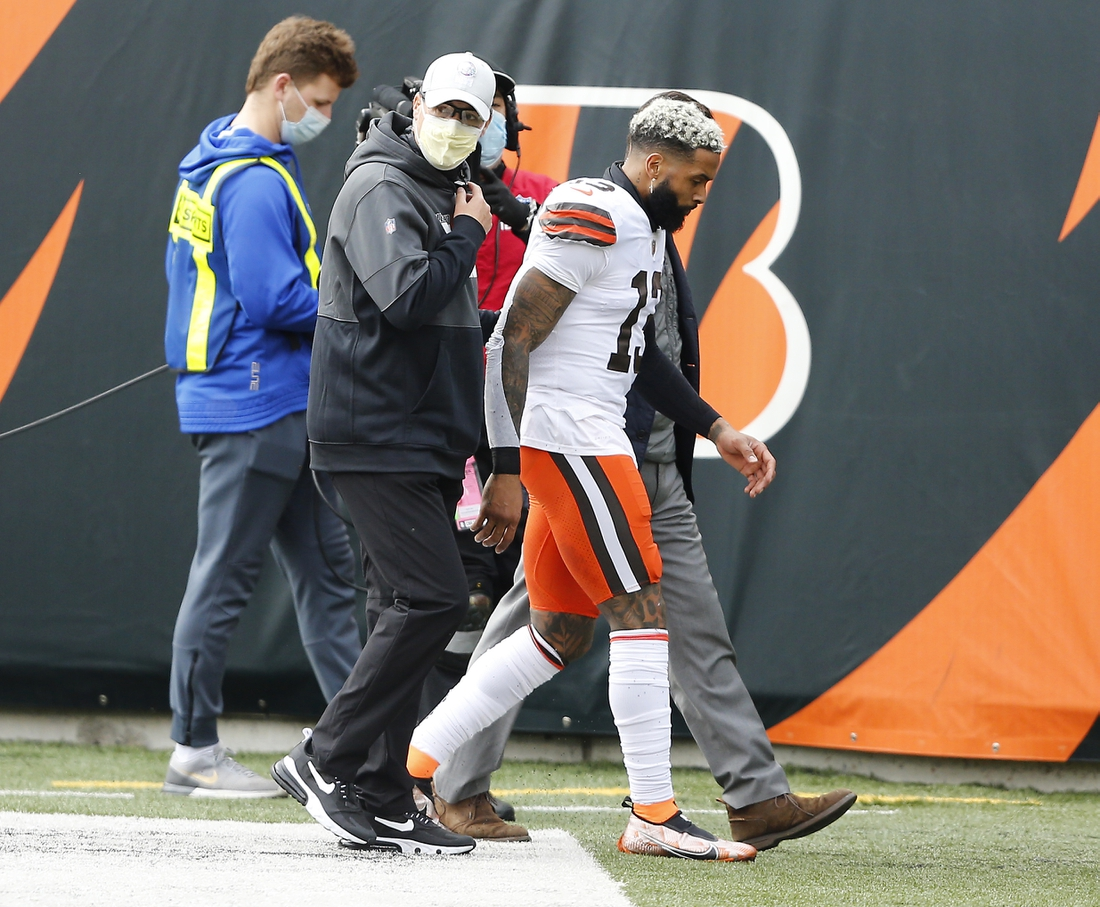 Oct 25, 2020; Cincinnati, Ohio, USA; Cleveland Browns wide receiver Odell Beckham Jr. (13) leaves the game with an apparent injury during the first quarter against the Cincinnati Bengals at Paul Brown Stadium. Mandatory Credit: Joseph Maiorana-USA TODAY Sports