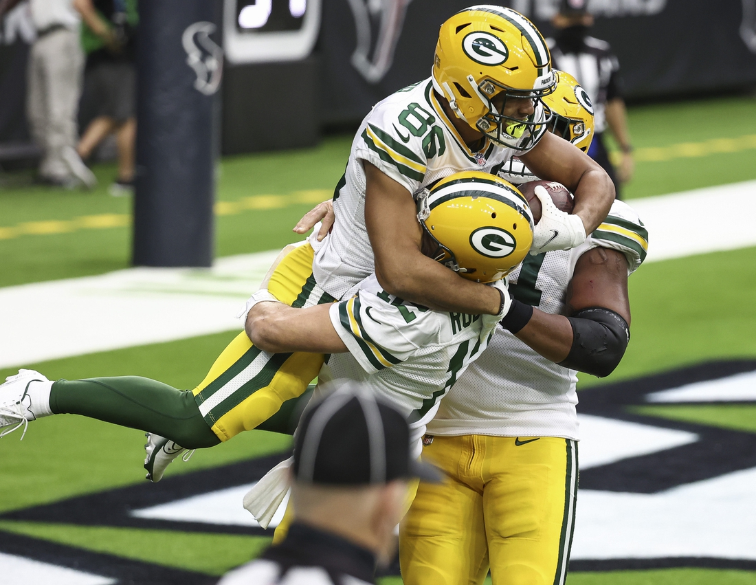 Oct 25, 2020; Houston, Texas, USA; Green Bay Packers wide receiver Malik Taylor (86) celebrates with quarterback Aaron Rodgers (12) after scoring a touchdown during the second quarter against the Houston Texans at NRG Stadium. Mandatory Credit: Troy Taormina-USA TODAY Sports