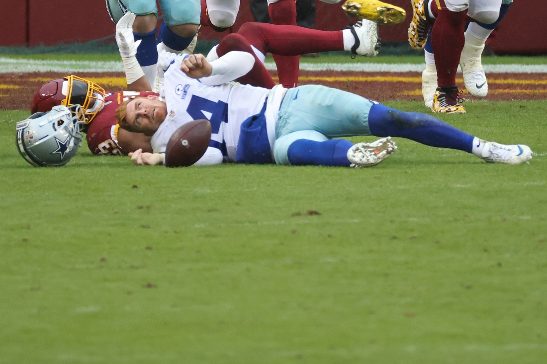 Oct 25, 2020; Landover, Maryland, USA; Dallas Cowboys quarterback Andy Dalton (14) is hit by Washington Football Team inside linebacker Jon Bostic (53) and knocked out of the game in the third quarter at FedExField. Mandatory Credit: Geoff Burke-USA TODAY Sports