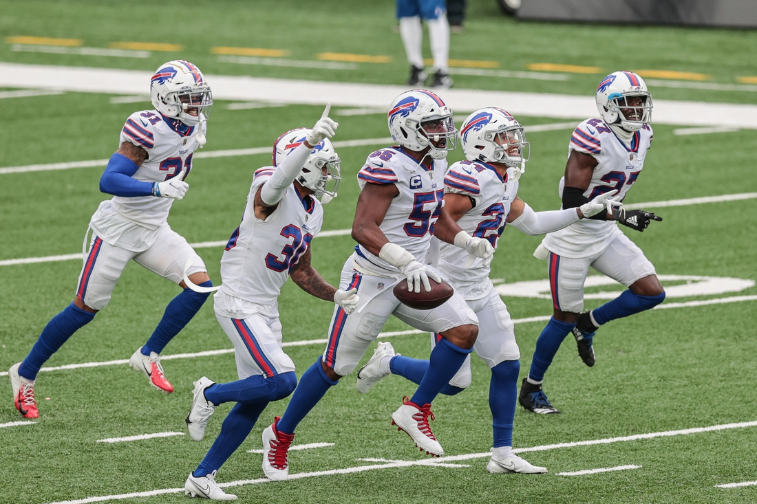 Oct 25, 2020; East Rutherford, New Jersey, USA; Buffalo Bills defensive end Jerry Hughes (55) celebrates his interception with teammates during the second half against the New York Jets at MetLife Stadium. Mandatory Credit: Vincent Carchietta-USA TODAY Sports
