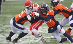 Oct 25, 2020; Denver, Colorado, USA; Kansas City Chiefs running back Clyde Edwards-Helaire (25) rushes for a touchdown past Denver Broncos cornerback Michael Ojemudia (23) in the first quarter at Empower Field at Mile High. Mandatory Credit: Ron Chenoy-USA TODAY Sports