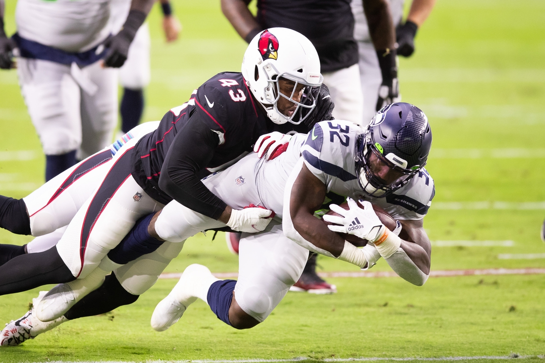 Oct 25, 2020; Glendale, Arizona, USA; Seattle Seahawks running back Chris Carson (32) is tackled by Arizona Cardinals outside linebacker Haason Reddick (43) in the first quarter at State Farm Stadium. Mandatory Credit: Billy Hardiman-USA TODAY Sports