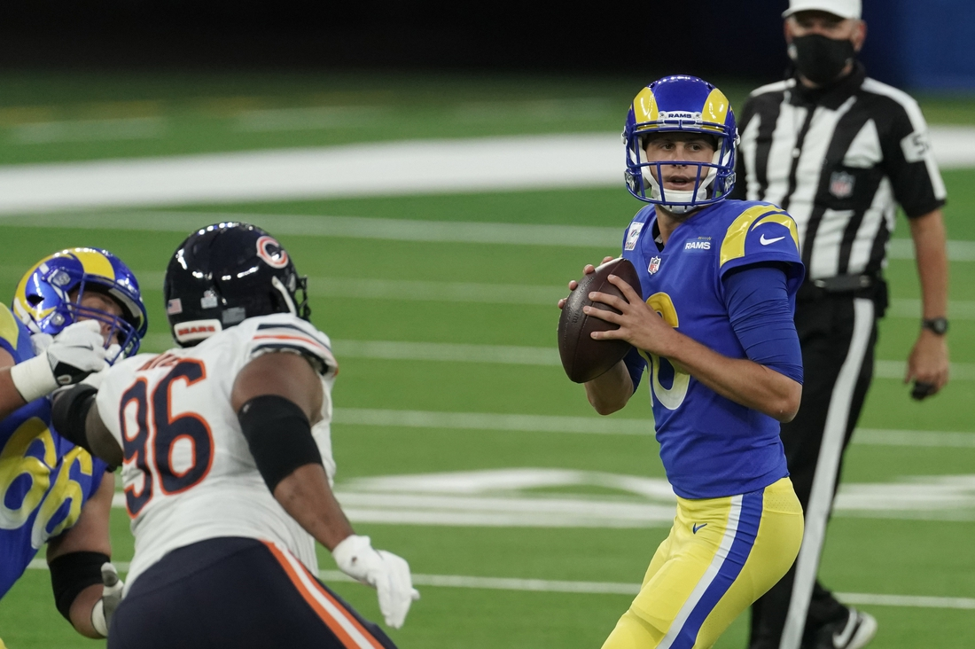 Oct 26, 2020; Inglewood, California, USA; Los Angeles Rams quarterback Jared Goff (16) looks to pass against the Chicago Bears during the first half at SoFi Stadium. Mandatory Credit: Kirby Lee-USA TODAY Sports