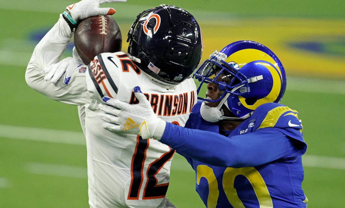 Oct 26, 2020; Inglewood, California, USA; Chicago Bears wide receiver Allen Robinson (12) hauls in a catch in front of Los Angeles Rams cornerback Jalen Ramsey (20) during the second half at SoFi Stadium. Mandatory Credit: Kirby Lee-USA TODAY Sports