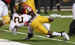Oct 30, 2020; College Park, Maryland, USA;   Minnesota Golden Gophers running back Mohamed Ibrahim (24) dives into the end zone for a second quarter touchdown as Maryland Terrapins defensive back Tarheeb Still (12)  defends  at Capital One Field at Maryland Stadium. Mandatory Credit: Tommy Gilligan-USA TODAY Sports